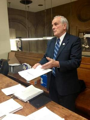 Robert Schulz, the lead plaintiff in the case to toss out the gun law, provides documents to reporters at the Capitol on Friday. / By Haley Viccaro, Albany Bureau